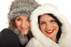 Closeup of beauty women in fur hats royalty free stock photo