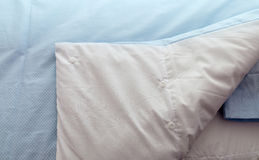 Closeup of a bed with blue linen in the bedroom Royalty Free Stock Image