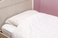 Closeup of a bed with pink linen in the bedroom Stock Photography