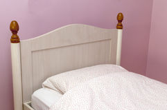 Closeup of a bed with pink linen in the bedroom Royalty Free Stock Images
