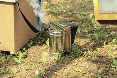 Closeup Of Bee Smoker. On crate at farm Royalty Free Stock Photography