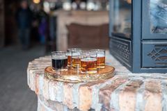 Beer flight on brick surface at local microbrewery stock image