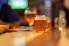 Beer flight on wood table at microbrewery royalty free stock photos