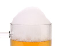 Closeup of beer glass with foam. Royalty Free Stock Photo