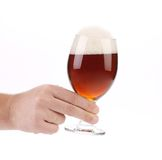 Closeup of beer glass in hand. Stock Photography