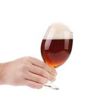 Closeup of beer glass in hand. Stock Image
