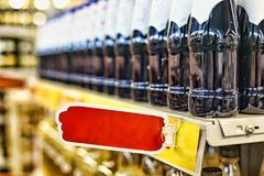 The concept: trade in a supermarket, the action, sale. Closeup: beer, wine or drinks without alcohol on the shelves of the superma. Closeup: beer, wine or drinks Royalty Free Stock Photo
