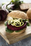 Beet burger sandwich on a table Stock Photography