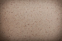 Closeup beige brown spotted texture background pattern Stock Image