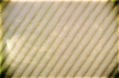 Closeup beige sponge foam with vignette as background texture Stock Images