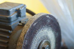 Closeup of bench grinder old wheel Royalty Free Stock Photography