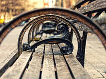 Closeup bench Manhattan New York City. Closeup bench in Manhattan New York City royalty free stock image