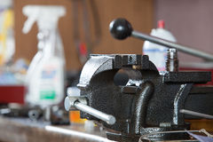 Closeup of bench vice at workroom Royalty Free Stock Photo