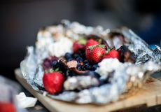 Closeup Of Berry Dessert In Aluminum Foil Stock Photo