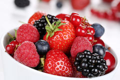 Closeup berry fruits in bowl with strawberries, blueberries and Stock Images