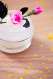 Closeup of beuty lotion with pink rose Stock Photo