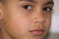 Closeup of Bi-Racial Boy's Face. The closeup shows a beautiful bi-racial boy's face and big brown eyes Royalty Free Stock Photos