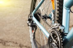 Closeup of a bicycle gears mechanism and chain on the rear wheel of mountain bike. stock photo