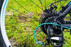 Closeup of a bicycle gears mechanism and chain on the rear wheel of mountain bike. stock image