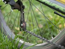 Closeup of a bicycle gears mechanism and chain on the rear wheel of mountain bike. Rear wheel cassette from a mountain stock photos