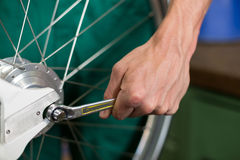 Closeup of bicycle mechanic with a wrench Royalty Free Stock Photo