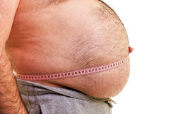 Closeup of a big belly surrounded by a measuring tape Royalty Free Stock Photos