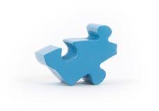 Closeup of big blue jigsaw puzzle piece Stock Photos