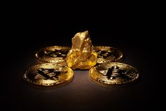 Closeup of big gold nugget and Gold Bitcoins Coins. On black background. Bitcoin cryptocurrency. Business concept Royalty Free Stock Photos