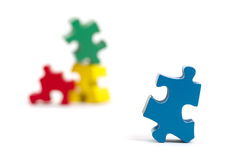 Closeup of big jigsaw puzzle piece, perspective Stock Images