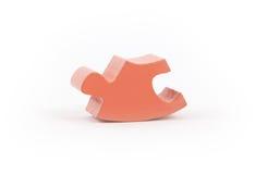 Closeup of big orange jigsaw puzzle piece Royalty Free Stock Photo