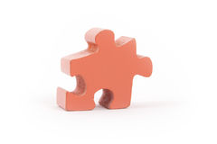 Closeup of big orange jigsaw puzzle piece Royalty Free Stock Images