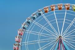 Closeup of Big Wheel on Blue Sky. Colorful Amusement Park Big Wheel on Clear Blue Sky Stock Image