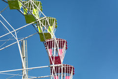 Closeup of Big Wheel on Blue Sky. Colorful Amusement Park Big Wheel on Clear Blue Sky Stock Images