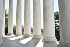 Closeup of white stone pillars at the Jefferson Monument on Lake Tidal Basin in Washington D.C in the USA. Closeup of big white stone pillars at the Jefferson Royalty Free Stock Photos