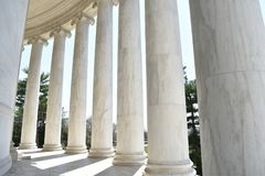 Closeup of white stone pillars at the Jefferson Monument on Lake Tidal Basin in Washington D.C in the USA. Closeup of big white stone pillars at the Jefferson Royalty Free Stock Images