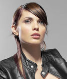 Closeup of bike girl. With leather jacket royalty free stock image