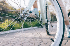 Closeup of bike wheel with chrome spokes Royalty Free Stock Images