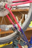 Closeup of bike wheel over workshop table Stock Photo