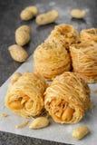 Closeup of birds nest baklava dessert with peanuts Royalty Free Stock Images