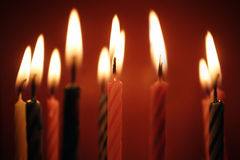Closeup of birthday candles all lit.