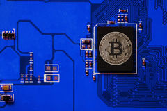 Closeup of bitcoin  circuit board with bitcoin processor Stock Photos