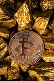 Closeup of bitcoin digital currency and gold nugget or gold ore on black background, precious stone or lump of golden stone,. Cryptocurrency money financial and stock photos