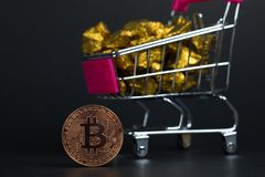 Closeup of bitcoin digital currency and gold nugget or gold ore in trolley, precious stone or lump of golden stone, Cryptocurrency. Money financial and business royalty free stock photos