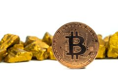 Closeup of bitcoin digital currency and gold nugget or gold ore on white background, precious stone or lump of golden stone,. Cryptocurrency money financial and royalty free stock photography