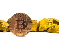 Closeup of bitcoin digital currency and gold nugget or gold ore on white background, precious stone or lump of golden stone,. Cryptocurrency money financial and stock photos