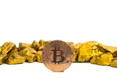 Closeup of bitcoin digital currency and gold nugget or gold ore on white background, precious stone or lump of golden stone,. Cryptocurrency money financial and royalty free stock photos