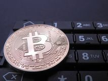 Bitcoin on top of numeric keyboard Royalty Free Stock Photo