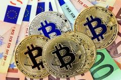 Bitcoin virtual coins on euros banknotes. Closeup, macro shot royalty free stock images
