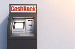 Closeup of a black atm machine near a concrete wall. Closeup of a black atm machine standing near a concrete wall. There is a cash back sign above it. Mock up Stock Photos