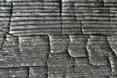 Closeup black burnt part of the wooden board as abstract background stock photos
